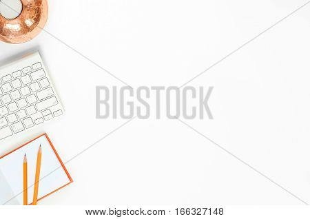 Minimal elegant desk composition flat lay with notebook and candle