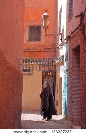 MARRAKESH, MOROCCO - APRIL 20, 2013: An alley inside Marrakesh Medina