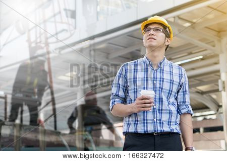 Foreman construction worker holding blueprint, architecture workplace