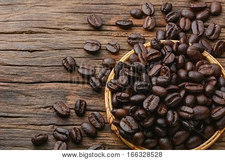 Top view of Coffee beans on brown wooden table