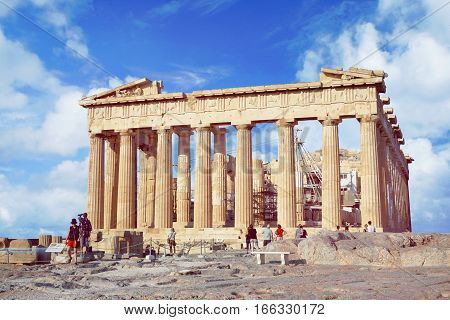 ATHENS - SEPTEMBER 10: People walk around the Parthenon on the Acropolis on summer sunny day on 10th of September, 2016 in the Athens.