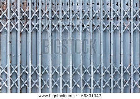 Old steel door texture pattern or steel door background with rusty metal. Grunge retro vintage of steel door for design.