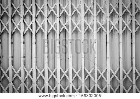 Old steel door texture pattern or steel door background with rusty metal. Grunge retro vintage of steel door for design. Black and white.