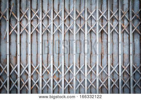 Old steel door texture pattern or steel door background with rusty metal. Grunge retro vintage of steel door for design. Dark edged.