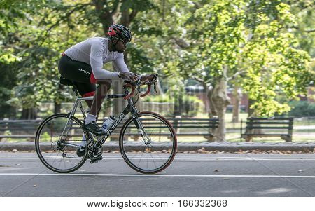 New York, September 17, 2016: A man is riding a bicycle in Central Park.