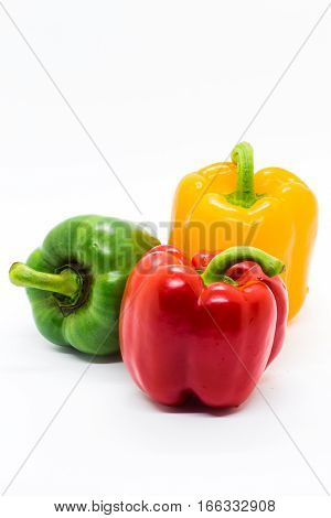 Multi color Bell peppers on white Background