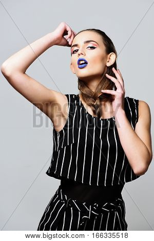 Pretty Girl In Striped Suit With Blue Lips