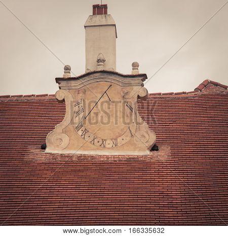 sundial on a  church in durnstein auatria