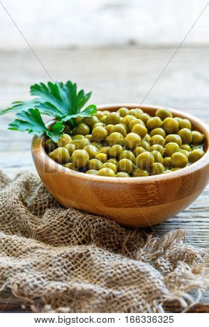 Wooden Bowl With Canned Green Peas.