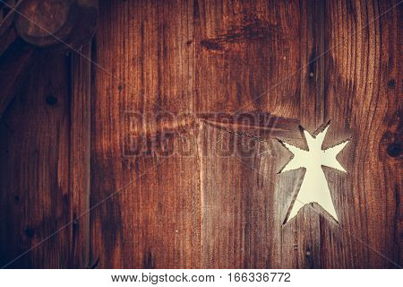 Close up shot of a cross wooden decoration in Maramures Romania.