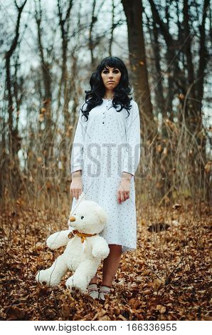 Young Sad Lonely Brunette Girl At Sleepwear With Soft Toy Bear On Hands.