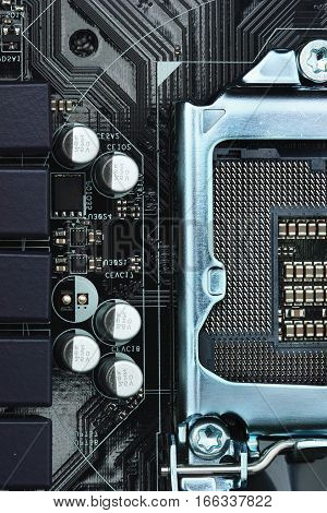 Empty cpu processor socket on a computer motherboard with pins visible. Concept computer harware