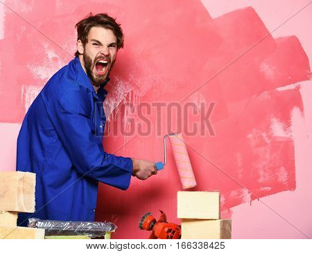 Shouting Builder Holding Paint Roller