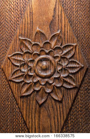Carved rose detail on a wooden door.