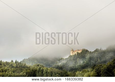 Castle Podčetrtek surrounded by morning mist located in Slovenia.