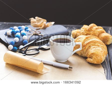 French Croissant, Glasses, Coffee And Notebook. Workplace Concept