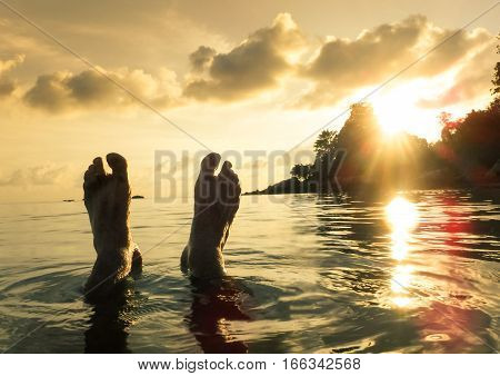 Naked human barefeet at seaside water during sunset in Koh Lipe - Wanderlust travel concept with wonderful South East Asia destination in Thailand - Soft detailed focus for backlight waterproof camera