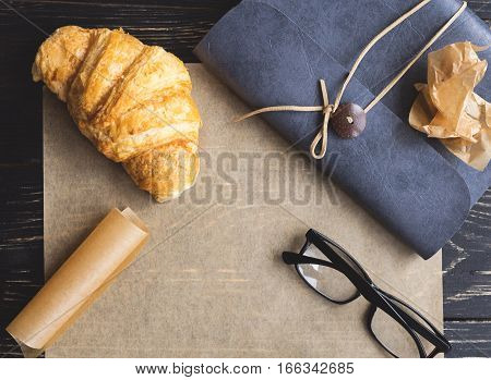 French Croissant, Glasses And Notebook. Workplace Concept