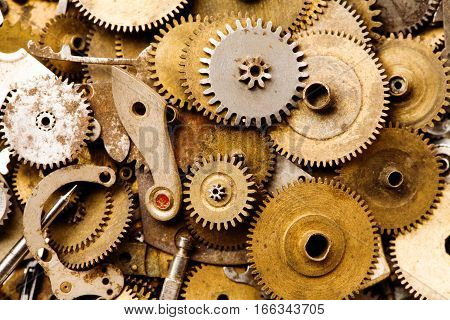 Clockwork vintage parts and steampunk cogs gears background. Aged mechanical clock wheels close-up. Shallow depth of field