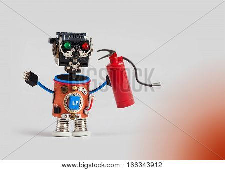 Fire prevention and safety concept. Abstract fireman with light bulb. Plastic head, colored green red eyes, electric wire hands, gears cog wheel and clock parts mechanism. Fun toy character concept. Gradient background, macro copy space