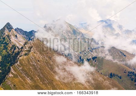 View of Alps and clouds at the Rochers de Naye Switzerland