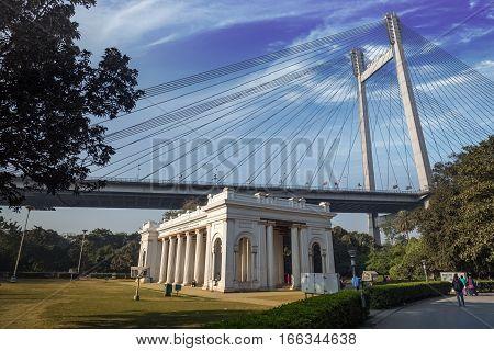 KOLKATA, INDIA -JANUARY 22, 2017:: Vidyasagar bridge (Setu) as seen from Princep Memorial (Ghat) a notable architectural landmark in the city of Kolkata.