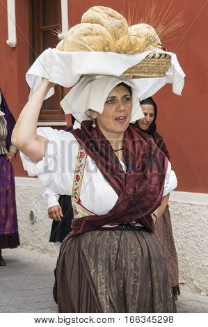 QUARTU S.E., ITALY - September 21, 2014: Parade of Sardinian costumes and floats for the grape festival in honor of the celebration of St. Helena.