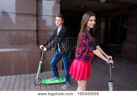 Couple Travel On Scooters