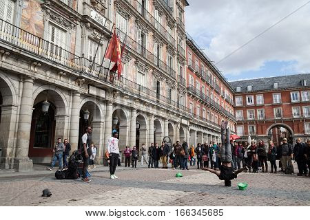 Madrid, Spain - February 21, 2014: Spaniards and foreigners work in the Plaza Mayor in Madrid to earn money.