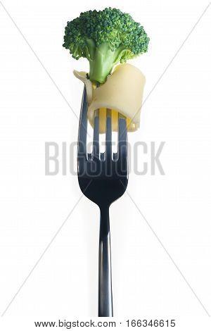 Fresh Broccoli on fork isolated on white background