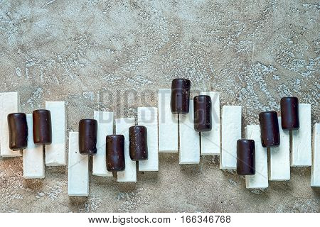 Sweet music concept - candy piano keys with copy space for your inscription.