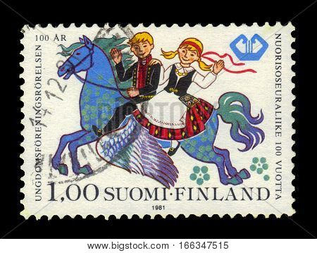 FINLAND - CIRCA 1981: a stamp printed in Finland shows boy and girl riding on Pegasus, series 100 years youth associations, circa 1981