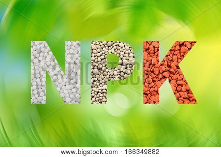 NPK letters made of mineral fertilizers on the white background. N - nitrogen P - phosphorus K - potassium (kalium)