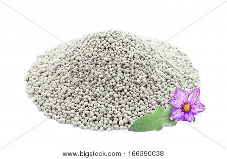 Heap Of Composite Mineral Fertilizers With Leaf And Flower, Isolated On White