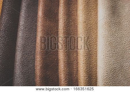 Natural variegated fabric leather background closeup texture
