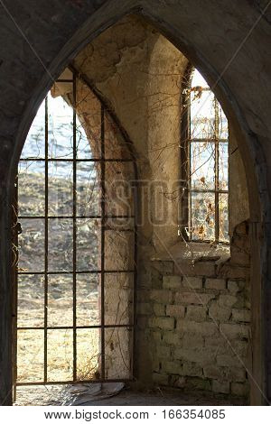 bars on the window and door in an old Romanesque church