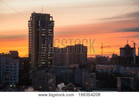 Modern buildings and skyscrapers of Voronezh on background of crimson sunset