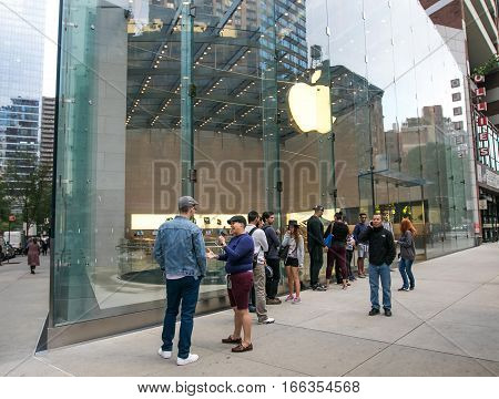 New York, September 28, 2016: People are lining up in front of an Apple store in anticipation of its opening.