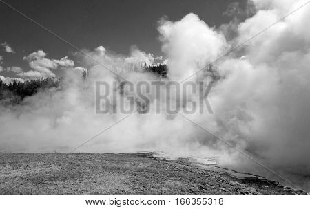 Excelsior Geyser in the Midway Geyser Basin next to the Firehole River in Yellowstone National Park in Wyoming USA - black and white