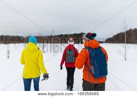 Sport young people on walk in winter woods