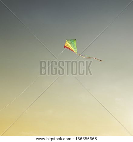 Photograph of a kite made with colored paper on blue sky