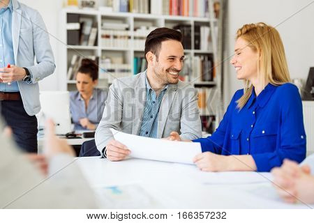 Business people working in office and collaborating