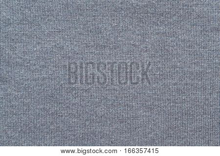woven texture of woolen fabric or yarn closeup for a background or for wallpaper of ashy color