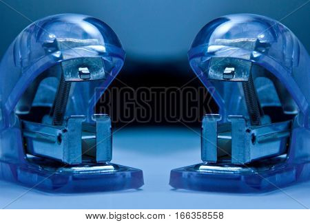Blue office staplers. Staplers close up detail