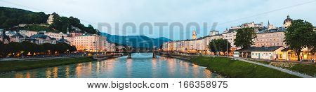 Beautiful panoramic view of Salzburg skyline with Festung Hohensalzburg and Salzach river at blue hour Salzburger Land Austria