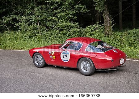 PASSO DELLA FUTA (FI) ITALY - MAY 21: driver and co-driver on a rare classic car Ferrari 250 MM Berlinetta Pininfarina (1953) in italian historical race Mille Miglia on May 21, 2016 in Passo della Futa (FI) Italy