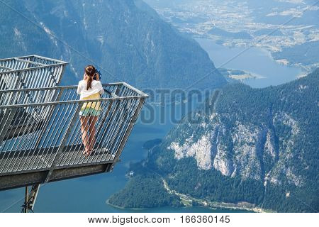 Young Girl Standing On The Viewing Platform Five Fingers And Observing With Tourist Binocular Specta