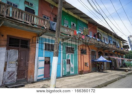 June 9 2016 Colon Panama: while the houses are painted in bright colours they are generally neglected in the tropical port town