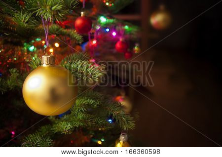 Christmas tree and decorations with living room interior in the background copy space. Holidays at home.