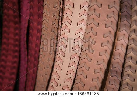Set of leather handmade colorful belts on a market